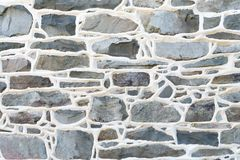 Historic Stone Wall Detail with raised mortar joints. Royalty Free Stock Photos