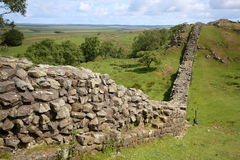 Historic stone wall in open countryside Royalty Free Stock Photos