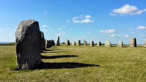 Historic stones on meadow with blue sky. In scotland or england Royalty Free Stock Photo
