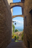 Historic street of Assisi with views of the Umbrian countryside. And oleander flower Stock Photos
