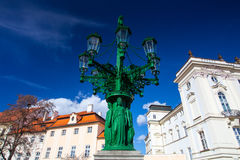 Historic Street lamp and Archbishop's Palace at the Castle Squar Stock Photography