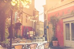 Historic street of south France, coffee house and sunny calm mood of small town alley royalty free stock images