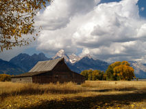 Historic Structure and Grand Tetons Stock Photo