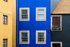 Old brightly colored buildings with stucco painted in yellow, blue, and black hues in Porto, Portugal. Historic stuccoed buildings in Porto, Portugal painted in royalty free stock photo