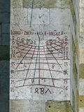 The historic sun-dial at the cathedral of Regensburg. The historic sun-dial at the cathedral `St. Peter` of Regensburg in Bavaria. The Cathedral  is the most Royalty Free Stock Photos