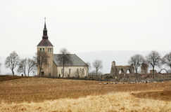 Historic Swedish church. A view across an open field to the historic Gudhem church and monastery ruins.  Gudhem, Sweden Stock Images