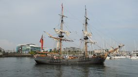 Historic tall ship sails into Plymouth harbour stock video footage