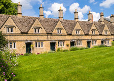 Historic Terraced Houses in an English Village. A terraced row of 17th century almshouses in a Cotswold village. Chipping Norton, Oxfordshire, England, UK royalty free stock photography