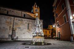 Statue of Andrea Doria as Neptune in Carrara. The historic 16th century fountain with a statue of Andrea Doria as Neptune by Baccio Bandinelli, locally wellknown stock photography