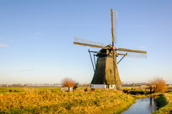 Historic thatched windmill in a Dutch polder Royalty Free Stock Photos