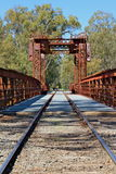 Historic Tocumwal rail bridge against a bright blue sky. Stock Images