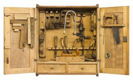 Historic tool cabinet. Old historic tool cabinet filled woth woodworking tools.Frontal shot with open doors in white back with clipping path royalty free stock photography