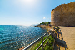 Historic tower in Alghero seafront Royalty Free Stock Images