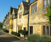The historic town of Chipping Campden. Golden stone buildings that run along the high street of chipping campden Stock Images