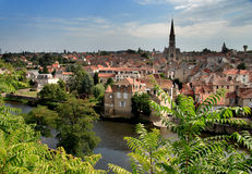 Historic Town in France. Historic medieval Town in Rural France viewed accross a Tranquil river Royalty Free Stock Photo