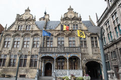 Historic town hall with flags and gold jewelery in Voerne, Belgi Royalty Free Stock Image