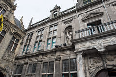 Historic town hall with flags and gold jewelry in Voerne, Belgiu Stock Image