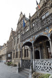 Historic town hall with flags and gold jewelry in Voerne, Belgiu Stock Photography