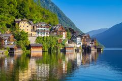 Historic town of Hallstatt in summer, Salzkammergut, Austria. Scenic picture-postcard view of traditional old wooden houses in famous Hallstatt mountain village Royalty Free Stock Images