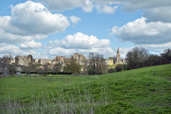 Historic town of Malmesbury and its Abbey Church, Wiltshire, UK. View of the historic town of Malmesbury and its picturesque Abbey Church on the hill, Malmesbury Royalty Free Stock Image