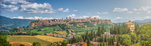 Historic town of Orvieto, Umbria, Italy. Beautiful panoramic view of the ancient etruscan town of Orvieto on a sunny day with blue sky in summer, Umbria, Italy Stock Photos