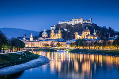 Historic town of Salzburg with Salzach river at dusk, Austria Royalty Free Stock Photography