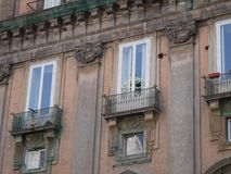 Historic townhouse windows with reflections Royalty Free Stock Images