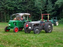 Historic tractors. Some historic traction engines in rural ambiance Royalty Free Stock Photos