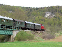 Historic train. Old fashioned german museum train crossing a bridge royalty free stock photos
