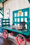 Historic train station, Big Valley, Alberta, Canada. Baggage cart with an antique scale sitting on it at the train station Royalty Free Stock Images