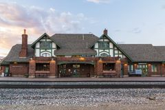Historic train station in Flagstaff Arizona. FLAGSTAFF, AZ – JUNE 2: The Amtrak passenger commuter railway station building located on historic Route 66  on Royalty Free Stock Image
