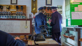In the historic train station. Slow motion RAW footage of a concocter and woman checking the control panel in the vintage train station in the country stock video