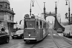 Historic tram and Freedom Bridge on background at foggy morning. royalty free stock photography