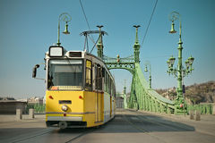 Historic tram on Freedom Bridge in Budapest, toned image Stock Image