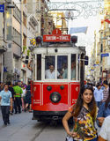 A historic tram on İstiklal Avenue. Istanbul, Turkey - September 9, 2012: the former tram on Istiklal Street in Istanbul, Taksim-Tunel carry passengers Royalty Free Stock Photos