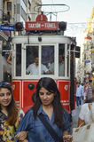 A historic tram on İstiklal Avenue. Istanbul, Turkey - September 9, 2012: the former tram on Istiklal Street in Istanbul, Taksim-Tunel carry passengers Royalty Free Stock Image