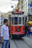 A historic tram on İstiklal Avenue. Istanbul, Turkey - September 9, 2012: the former tram on Istiklal Street in Istanbul, Taksim-Tunel carry passengers Stock Image