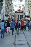 A historic tram on İstiklal Avenue. Istanbul, Turkey - September 9, 2012: the former tram on Istiklal Street in Istanbul, Taksim-Tunel carry passengers Stock Images