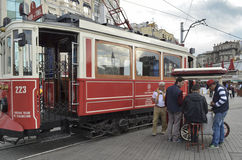 A historic tram on Istiklal Avenue. Istanbul, Turkey - September 21, 2012: the former tram on Istiklal Street in Istanbul, Taksim-Tunel carry passengers Royalty Free Stock Image