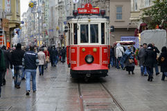 A historic tram on Istiklal Avenue. Istiklal Avenue in the Beyog. Istanbul, Turkey - September 21, 2012: the former tram on Istiklal Street in Istanbul, Taksim Royalty Free Stock Photos