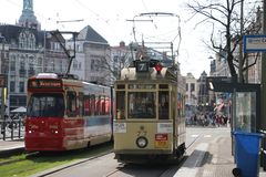 Historic tram 77 known as Ombouwer of the HTM on the rails in The Hague on the Lange Vijverberg as Museum Tram with normal GLT. Historic tram 77 known as stock photo