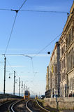 Historic tram on the road near the riverside to parliament building in Budapest, Hungary, on a bright day Stock Photo