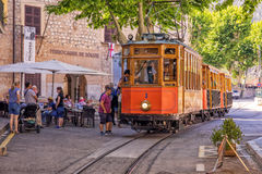 The historic Tram, Soller, Mallorca. Passengers boarding the historic Soller to Puerto de Soller Tram outside the railway information centre in Soller. This Stock Images