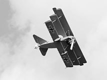 Historic triplane on the sky. Stock Image