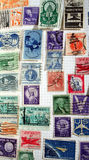 Historic U.S. Postage Stamps. A page from a stamp album depicting U.S. stamps at least 40 years old royalty free stock image
