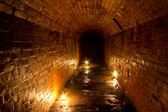 Historic underground passage under the abandoned fort.  Royalty Free Stock Photography