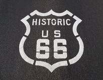 Historic US 66. Historic US Route 66 pavement road sign in California's Mojave desert Stock Photo
