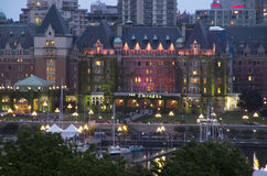 Historic Victoria BC. Inner harbor of Victoria BC in beautiful lights with The Fairmont Empress hotel in the middle Royalty Free Stock Photo