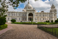 Historic Victoria Memorial monument building at Kolkata, India. Built in the memory of Queen Victoria this marble architectural building and monument is an Stock Photography