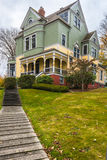 Historic Victorian House. Vertical imagae of historic 1888 Victorian Walker-Ames home in the Historic Rural Town of Port Gamble, Washington.  On the National Royalty Free Stock Photography